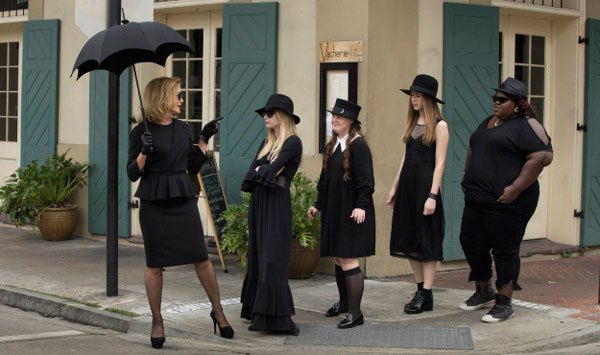 The girls from American Horror Story Coven demonstrating high end, low-end, and plus size strega silhouettes.